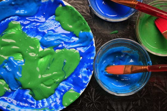Puffy paint Earth Day art project from Happy Hooligans - paper plate shown with green and blue paint