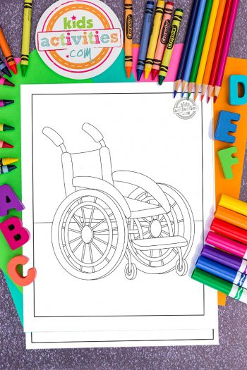 wheelchair coloring pages surrounded by coloring art supplies of crayons, pencils and markers