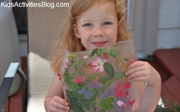 Easy nature collage art for younger kids like preschoolers - flowers and leaves pressed - great idea for Earth Day.