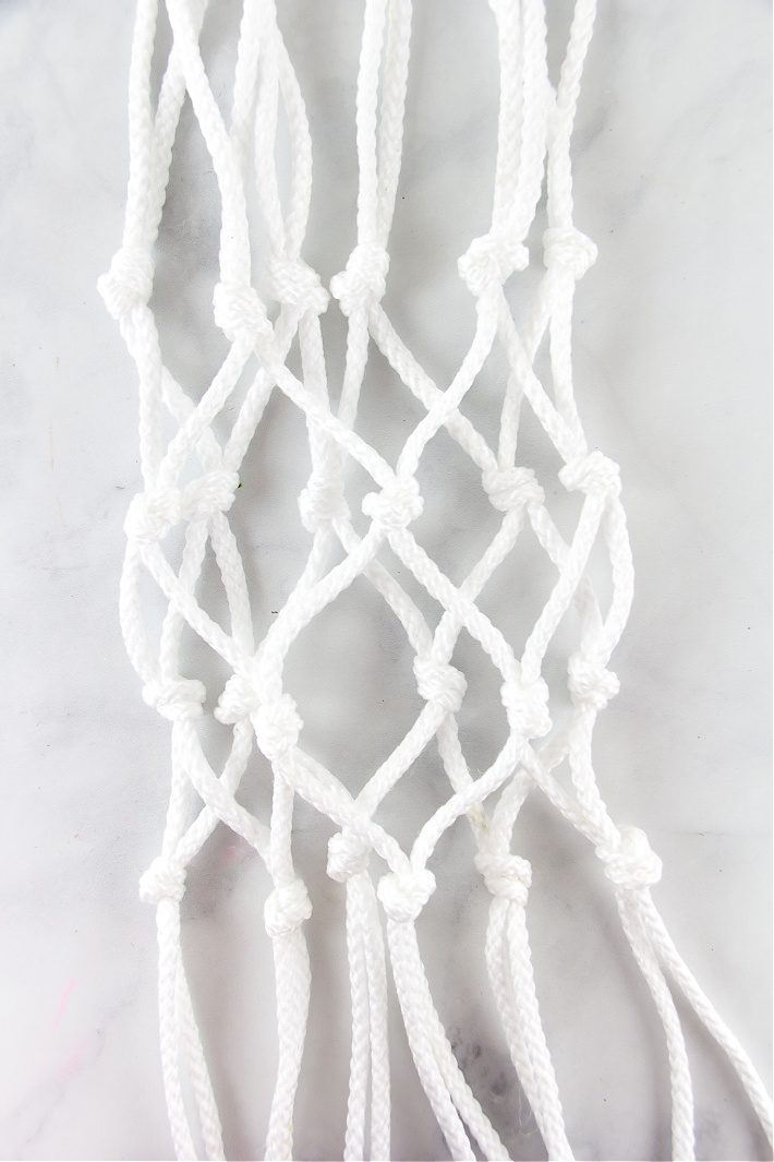 A macrame net that will go over a potted plant.