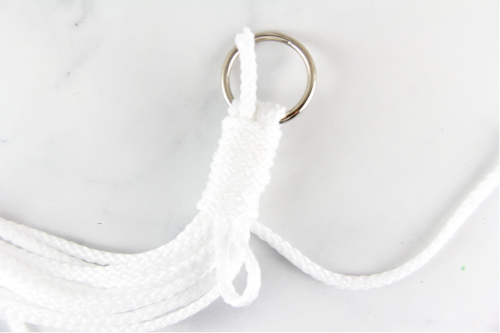 How to secure a knot under a ring for a macrame plant hanger.