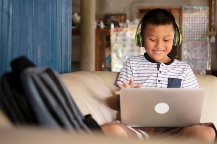 Great sites for education of kids for free - Kids Activities Blog - kid on couch watching video on computer