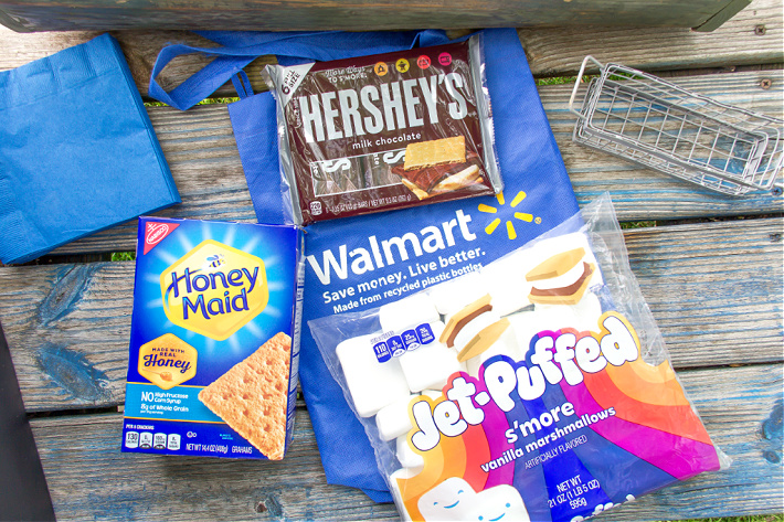 Ingredients to make s'mores at home including Honey Maid Graham Crackers, Jet-Puffed Marshmallows, and Hershey's Chocolate.