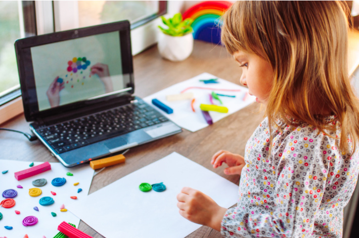 Interactive learning through computers for kids - Kids Activities Blog - child following instructions on a screen for art project