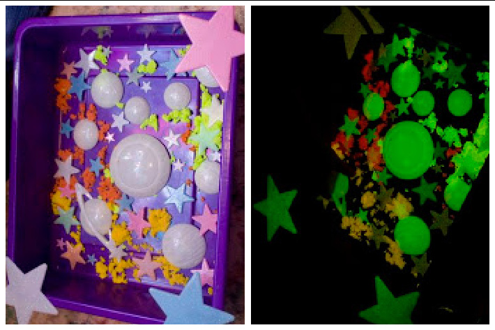 sensory bin that is outer space themed and glows in the dark