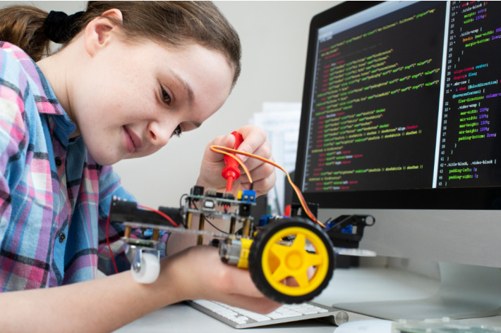 STEM education from home through interactive coding instruction - Kids activities blog - child making a car while coding it online