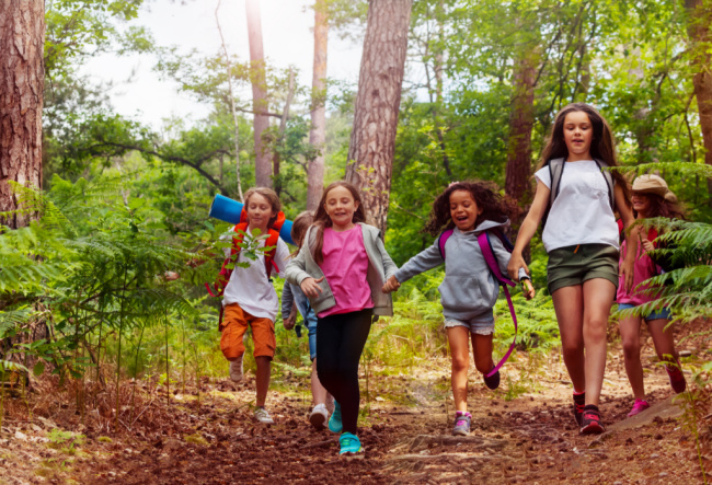 Summer camp activities and summer camp ideas along with camping activities for kids - ground of children running in the woods