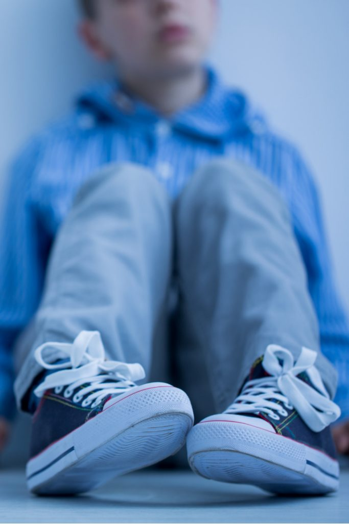 What to do when your child steals something - Kids Activities Blog - child sitting against wall