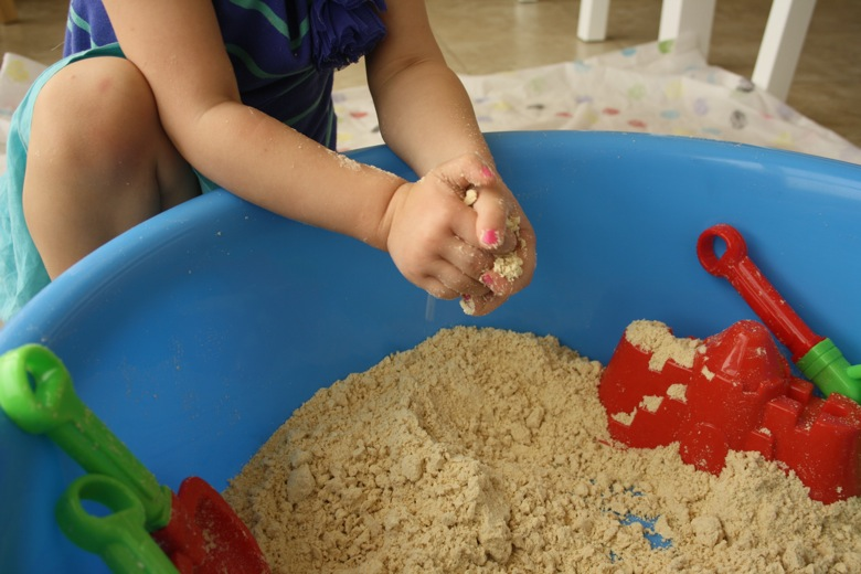 Indoor beach sensory bin from Mama Papa Bubba using sand and other sand play items