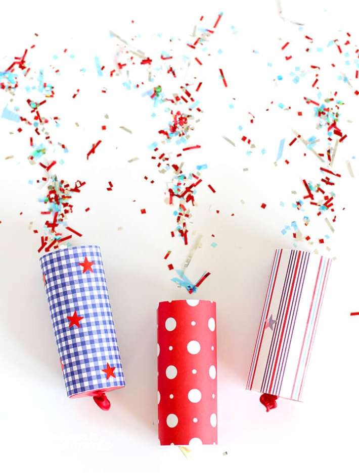 4th-of-July-Confetti-Poppers-from Happiness is Homemade - 3 confetti poppers shown in various red white and blue patterns