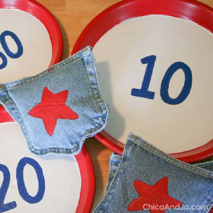 Go on an American Flag hunt for the 4th of July - Kids Activities Blog - denim bean bags and red and white paper plate goals shown