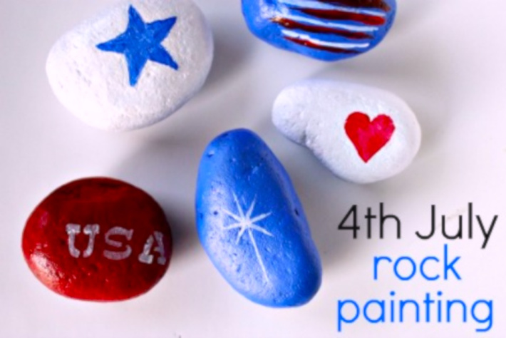 4th of July rock painting project from Multiples and More - several painted rocks shown in patriotic colors of red white and blue