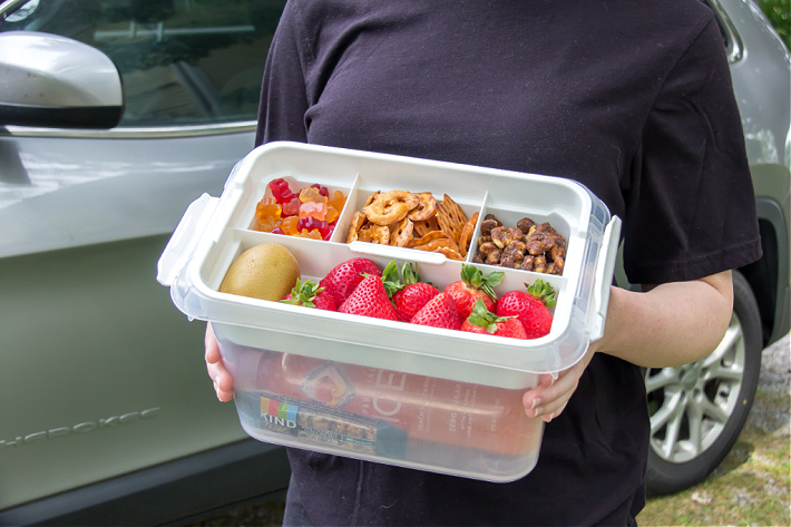 Snack and drink tub for kids to enjoy on a summer road trip.