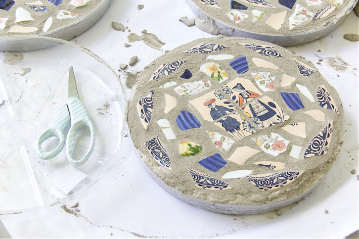 Concrete stepping stones made in a clear plastic saucer that gets cut off at the end.