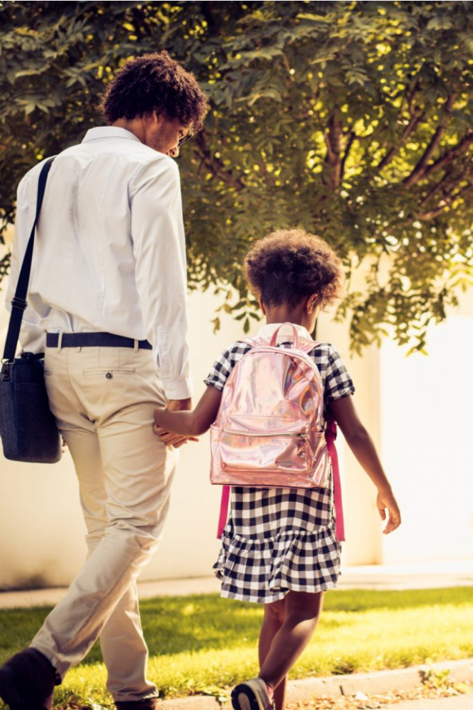 Back to School Traditions to start this year - Kids Activities Blog - parent and child walking to school together