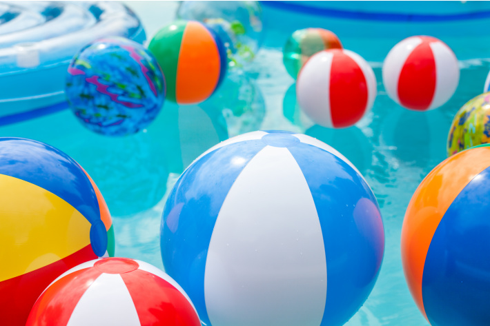 Beach balls in the pool ready for playing sight word game - Kids Activities Blog