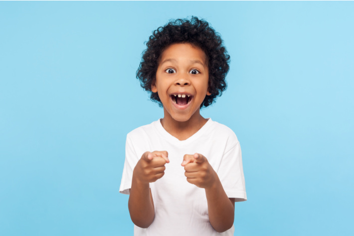 Child laughing at a back to school joke - Kids Activities Blog