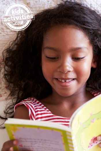 Creating-a-summer-reading-program-for-kids-at-home-Kids-Activities-blog - child reading a book