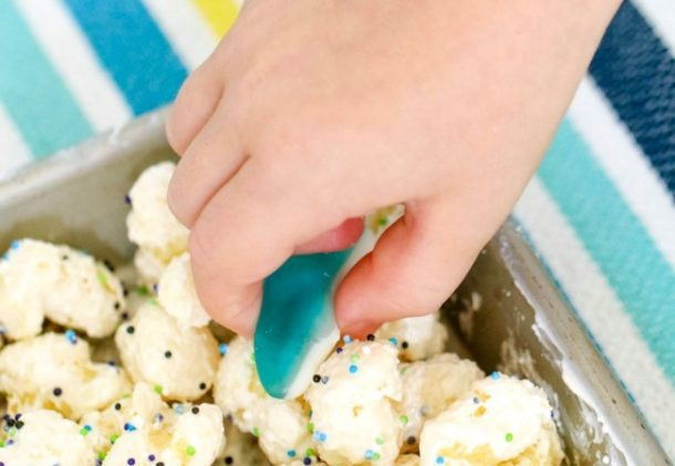 Shark bait trail mix has popcorn and other things along with gummy sharks with child's hand