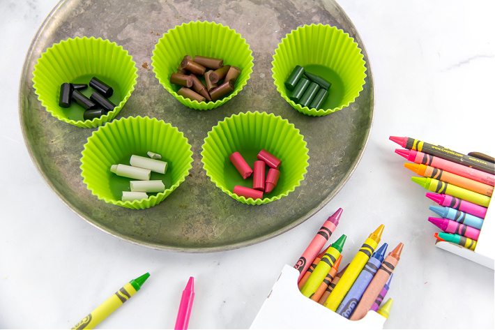 Melt crayons in individual silicone cupcake liners to make colors for your homemade candles.