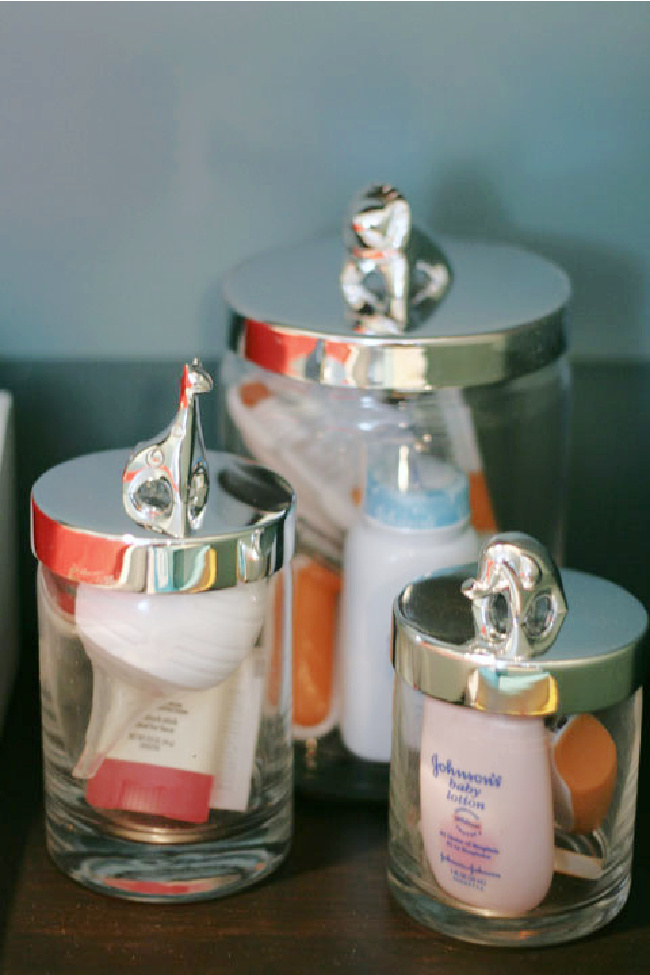 Nursery storage idea from I Heart Organizing - jars full of pacifiers, lotion, nose, and so much more