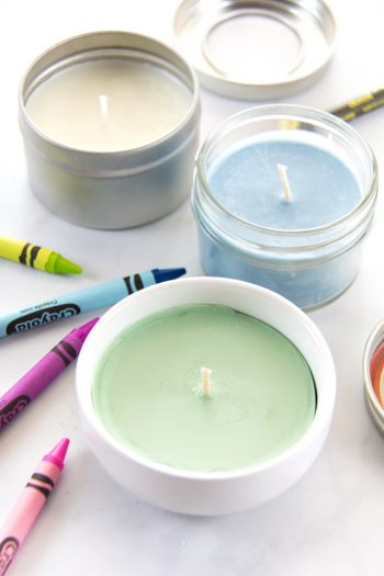 Homemade crayon candles in dishes, jars, and containers