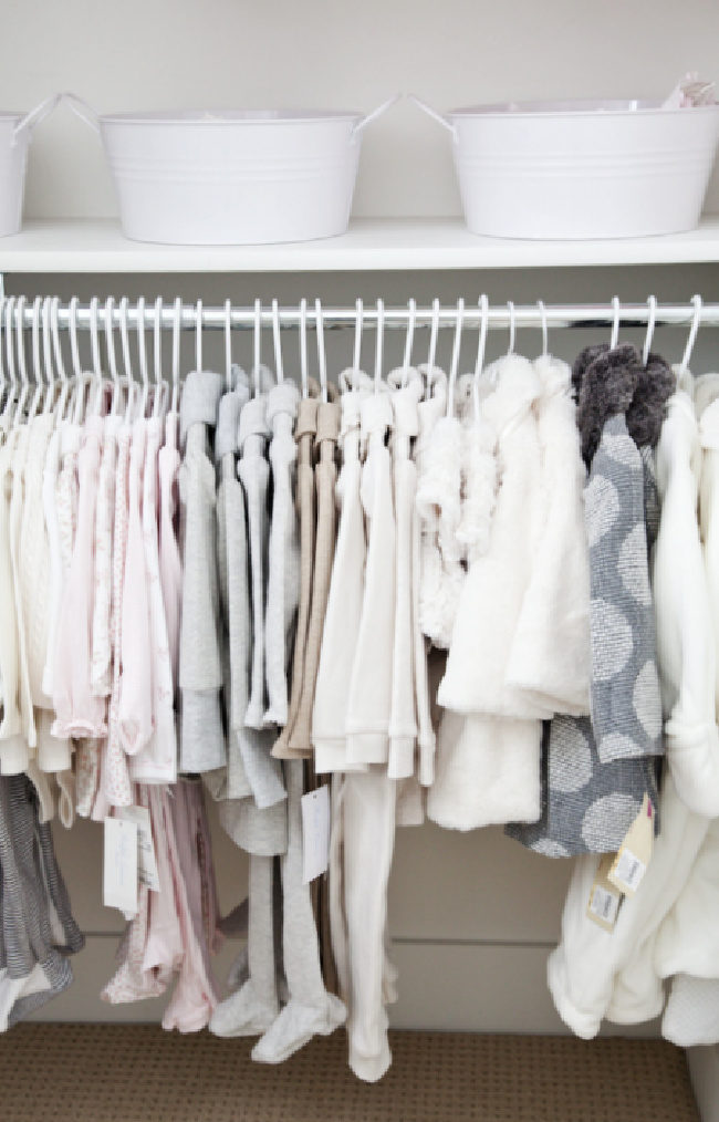 nursery from boxwood clippings - white clothes hanging in baby closet
