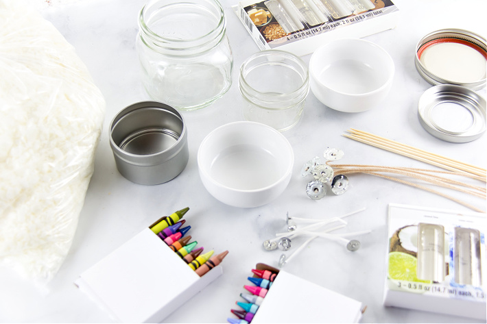 Supplies needed to make homemade candles using crayons and soy wax.