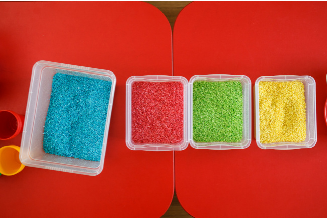 Dyed rice in the colors of blue red green and yellow - Kids Activities Blog
