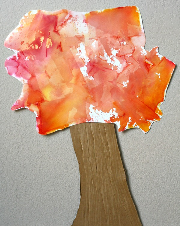 fall tissue paper art from Fantastic fun and learning - tree craft for kids shown with trunk and colorful leaves