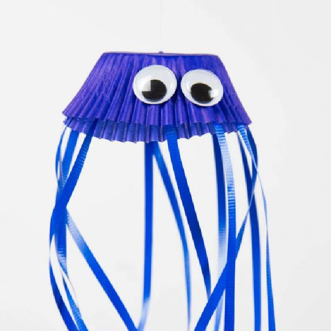 Jellyfish craft for kids using cupcake liner and ribbon - Kids Activities Blog