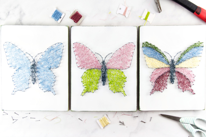 DIY string art butterflies made in a variety of colors for kids of different ages.