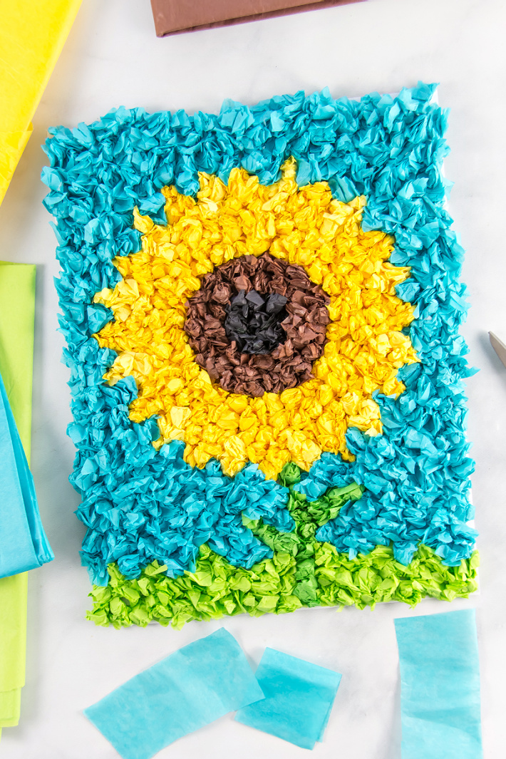 Tissue paper sunflower craft for kids to make at home.