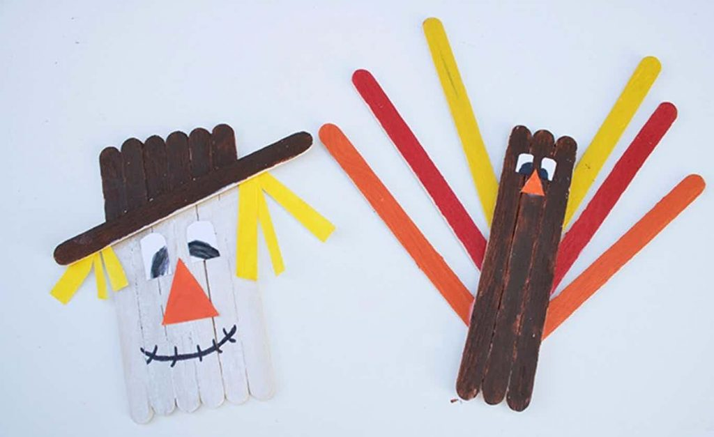 popsicle stick craft for autumn - scarecrow and turkey made of craft sticks