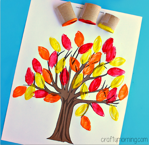 Toilet paper roll leaf stamping craft for kids from Crafty Morning shown here as a tree on blue background