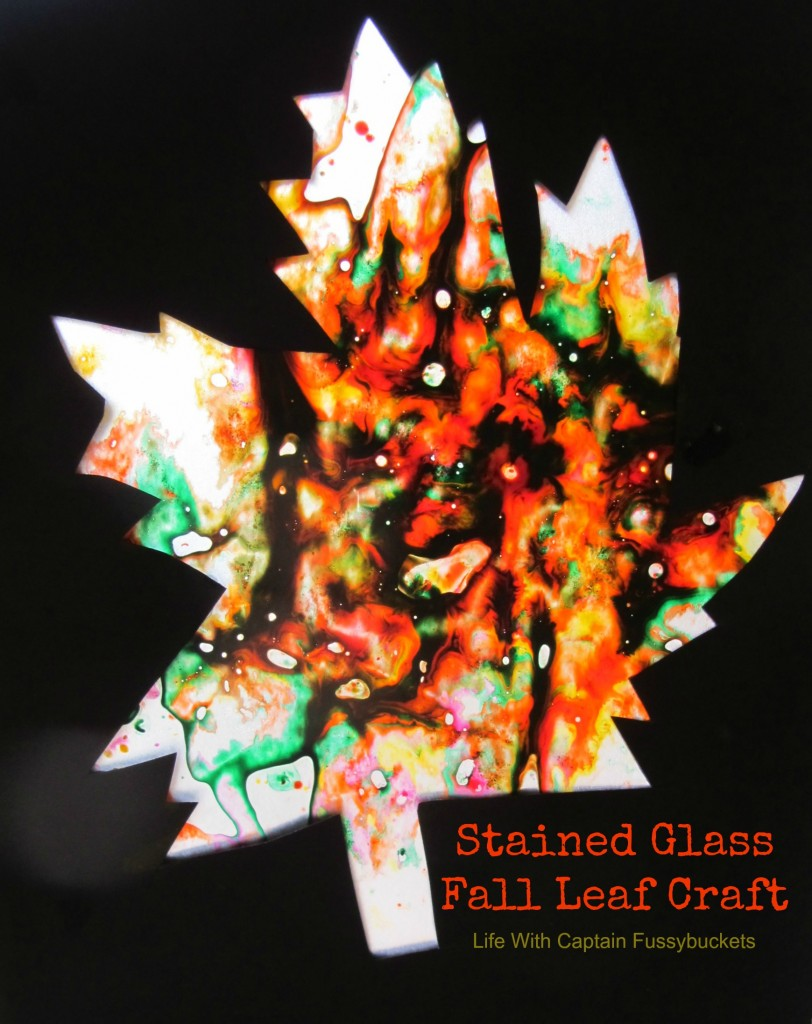 Fall stained glass leaf craft for kids from Ginger Casa shown on black with colorful leaf shape