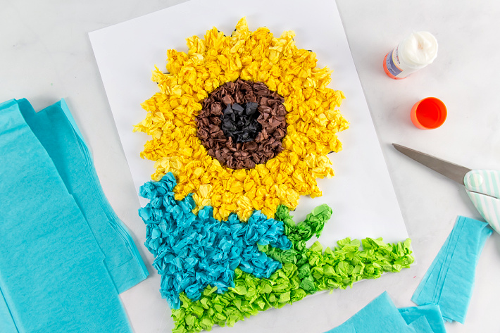 Tissue paper scrunched and glued to paper to make a sunflower.
