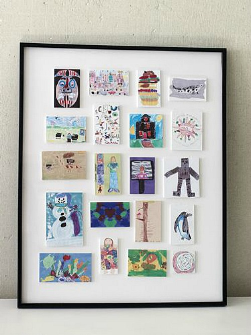 Size down kids large art pieces into a smaller more manageable artwork display from Clean and Scentsible