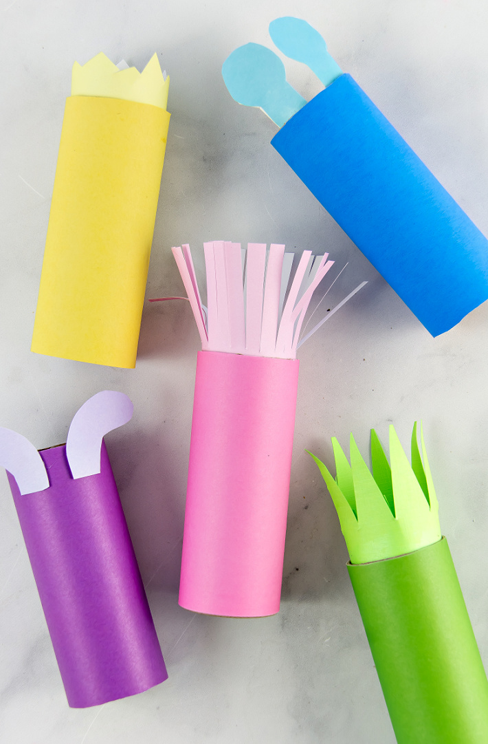 monster paper roll crafts for kids in bright colors using scrapbook paper