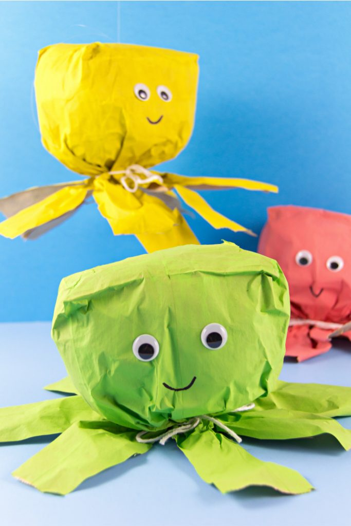 paper bag octopus crafts for kids from The Big Book of Kids Activities - three colors shown