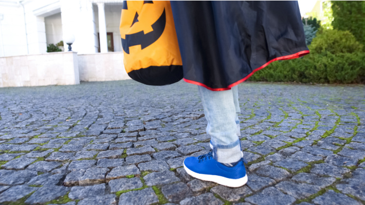 Trick or Treating - Kids Activities Blog - child feet and trick or treat bag on sidewalk