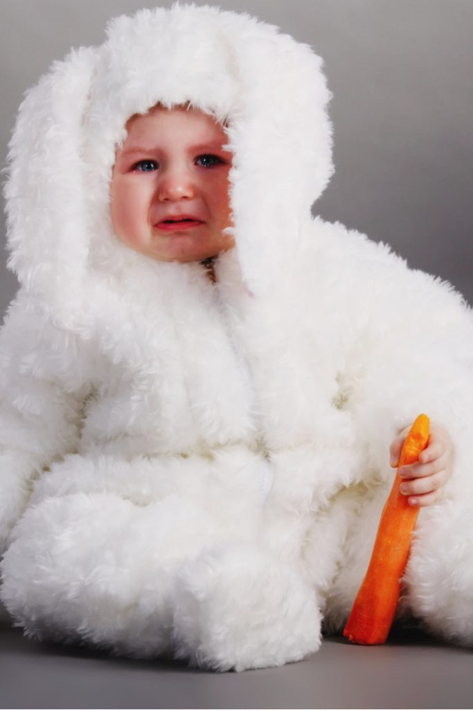 family Halloween costumes that make everyone happy almost - Kids Activities Blog - baby dressed as a bunny with a carrot crying