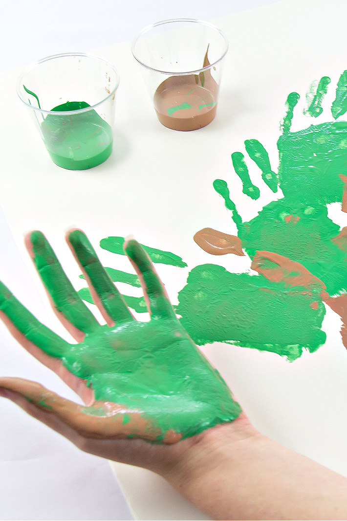 A hand painted green and brown to make branches and leaves for a handprint tree.