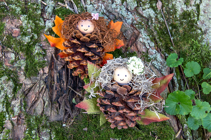 Fairies made out of pinecones, fall leaves, and wood beads.